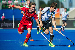 Germany's Florian Fuchs is tackled by Tom Boon of Belgium. Belgium v Germany - Unibet EuroHockey Championships, Lee Valley Hockey & Tennis Centre, London, UK on 22 August 2015. Photo: Simon Parker