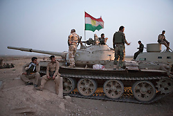 © Licensed to London News Pictures. 11/09/2015. Kirkuk, Iraq. A Kurdish peshmerga T62 tank waits for the beginning of an offensive to expand a safety zone around the city of Kirkuk, Iraq.<br /> <br /> The offensive, which went unchallenged after ISIS left the area ahead of the attack, saw the peshmerga capture 15 villages along the Kirkuk front line. The objective of the offensive was to expand the safety zone around Kirkuk, stopping militants from firing missiles and rockets in to the city of Kirkuk. 3 peshmerga were killed and 24 wounded due to improvised explosive devices left behind by the militants. Photo credit: Matt Cetti-Roberts/LNP