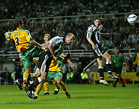 Photo. Andrew Unwin.<br /> Newcastle United v Norwich, Barclays Premiership, St James Park, Newcastle upon Tyne 25/08/2004.<br /> Newcastle's Alan Shearer (C) beats Norwich's Adam Drury (L) to the ball, but his header misses the target.