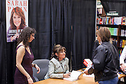 "23 NOVEMBER 2010 - PHOENIX, AZ:  SARAH PALIN greets customers and signs copies of her new book ""America by Heart"" at the Barnes and Noble store in Phoenix Tuesday night, Nov. 23. It was the kick off of her book tour to support America by Heart. Palin is frequently mentioned as a possible Republican candidate for US President in 2012.  Photo by Jack Kurtz"