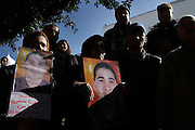 The Family of Majdi Mnassri, 25 years old, killed in January 12 by the police in Citè Ettdhaman, a neighborhood of Tunis, show his image during a demonstration under the building of governement demanding the dissolution of the new interim governement...On 17 december Mohamed Bouazizi a fruit seller form the city of Sidibouzid in Tunisia set fire to himself starting a wave of protest that will change several arab countries under the name of Arab Spring..Despite the dictator Zine El-Abidine Ben Ali left the country on 14 January after weeks of protest the demonstrations continue asking for the political party of the regime (RCD) and all the political men involved on the past government where banned from the political life .