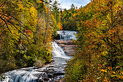Autumn colors surround Triple Falls at DuPont State Forest in Cedar Mountain, North Carolina.  <br /> <br /> &copy; Photography by Kathy Kmonicek