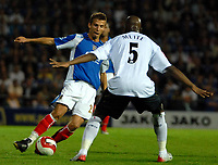 Photo: Ed Godden.<br /> Portsmouth v Bolton Wanderers. The Barclays Premiership. 25/09/2006. Portsmouth's Gary O'Neil (L) is met by Abdoulaye Meite.