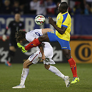 Mix Diskerud, (left), USA, is challenged by Segundo Castillo, Ecuador, during the USA Vs Ecuador International match at Rentschler Field, Hartford, Connecticut. USA. 10th October 2014. Photo Tim Clayton