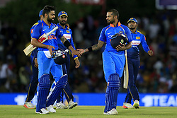 August 20, 2017 - Dambulla, Sri Lanka - Indian cricketers Virat Kohli and Shikhar Dhawan(R) walk back to the pavilion after securing a 9 wicket victory during the 1st One Day International cricket match bewtween Sri Lanka and India at Dambulla International cricket stadium situated in the Central Province and the first and only International cricket ground in the dry zone of Sri Lanka on Sunday 20 August 2017. (Credit Image: © Tharaka Basnayaka/NurPhoto via ZUMA Press)