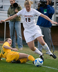 Virginia forward Sarah Curtis (18) avoids a tackle from William and Mary midfielder/forward Emily Kittleson (22).  The Virginia Cavaliers defeated the William and Mary Tribe 1-0 in the second round of the NCAA Women's Soccer tournament held at Klockner Stadium in Charlottesville, VA on November 18, 2007.