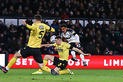 Millwall defender Murray Wallace (3) challenges Derby County midfielder Duane Holmes (23) during the EFL Sky Bet Championship match between Derby County and Millwall at the Pride Park, Derby, England on 14 December 2019.
