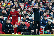 Brighton and Hove Albion Manager Graham Potter directs as Liverpool defender Andrew Robertson (26) takes the throw in during the Premier League match between Liverpool and Brighton and Hove Albion at Anfield, Liverpool, England on 30 November 2019.