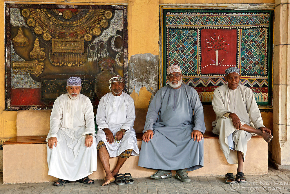 Omani men sitting in the Mutrah souk in Muscat, the capital of the sultanate of Oman.