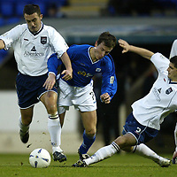 St Johnstone v Ross County....06.12.03<br />David Hannah and Stuart Malcolm bring down Chris Hay<br /><br />Picture by Graeme Hart.<br />Copyright Perthshire Picture Agency<br />Tel: 01738 623350  Mobile: 07990 594431