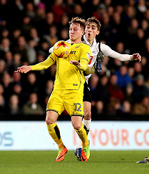 Cauley Woodrow of Burton Albion is challenged by Julien de Sart of Derby County - Mandatory by-line: Robbie Stephenson/JMP - 21/02/2017 - FOOTBALL - iPro Stadium - Derby, England - Derby County v Burton Albion - Sky Bet Championship