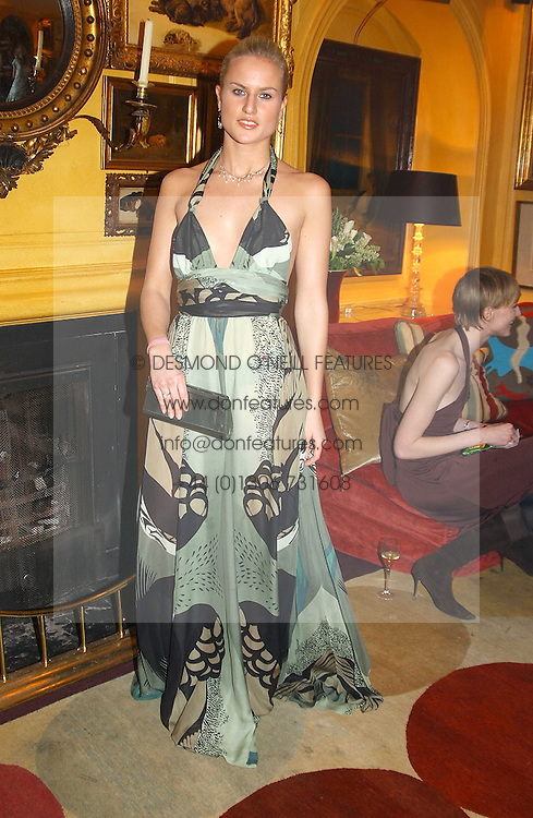 OLYMPIA SCARRY at a private dinner and presentation of Issa's Autumn-Winter 2005-2006 collection held at Annabel's, 44 Berkeley Square, London on 15th March 2005.<br /><br />NON EXCLUSIVE - WORLD RIGHTS