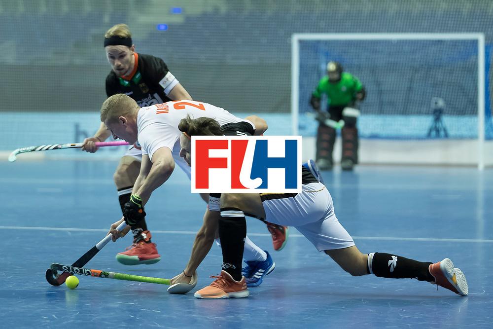 Hockey, Seizoen 2017-2018, 08-02-2018, Berlijn,  Max-Schmelling Halle, WK Zaalhockey 2018 MEN, Poland - Germany 3-6, KASPRZYK Michal (POL) en MILTKAU Marco (GER).