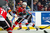 KELOWNA, CANADA - MARCH 3: Conner Bruggen-Cate #20 of the Kelowna Rockets back checks Clay Hanus #58 of the Portland Winterhawks  on March 3, 2019 at Prospera Place in Kelowna, British Columbia, Canada.  (Photo by Marissa Baecker/Shoot the Breeze)