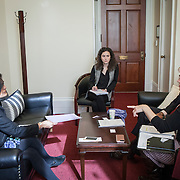 Representative Pramila Jayapal (D-WA, 7), left, and Danielle Fulfs, her Legislative Assistant, center, take their first constituent meeting of the day, speaking to Mary Fertakis, right, and -- of the Washington State School Directors Association, on Tuesday, January 31, 2017.  Among other topics of concern, they discussed the potential ramifications of President Trump's immigration and border security policies.  John Boal photo/for The Stranger