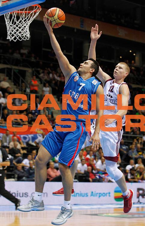 DESCRIZIONE : Siauliai Lithuania Lituania Eurobasket Men 2011 Preliminary Round Lettonia Serbia<br /> GIOCATORE : Ivan Paunic&nbsp;<br /> CATEGORIA : tiro<br /> SQUADRA : Lettonia Serbia<br /> EVENTO : Eurobasket Men 2011<br /> GARA : Lettonia Serbia<br /> DATA : 01/09/2011 <br /> SPORT : Pallacanestro <br /> AUTORE : Agenzia Ciamillo-Castoria/M.Metlas<br /> Galleria : Eurobasket Men 2011 <br /> Fotonotizia : Siauliai Lithuania Lituania Eurobasket Men 2011 Preliminary Round Lettonia Serbia<br /> Predefinita :