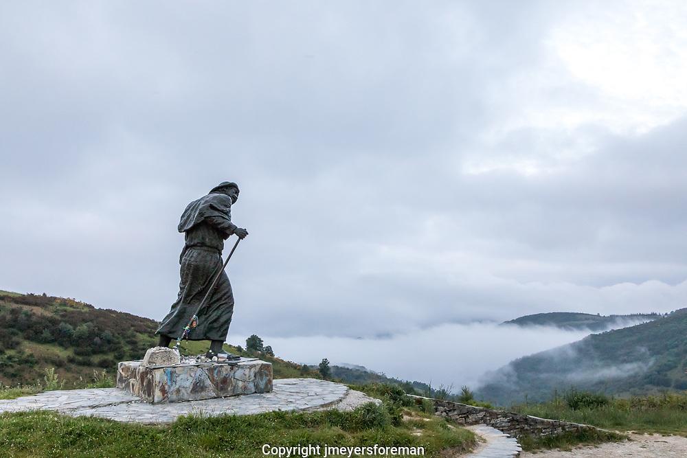 Wind battered pilgrim statue, Alto de San Roque along the Camino Frances, Spain