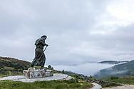 wind battered pilgrim statue, Alto de San Roque