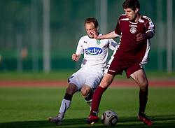 Davor Skerjanc of Olimpija  vs Petar Stojnic of Triglav during football match between NK Triglav Gorenjska and NK Olimpija in 27th Round of Slovenian 1st League PrvaLiga, on April 10, 2011 in Sports park Kranj, Slovenia. (Photo By Vid Ponikvar / Sportida.com)