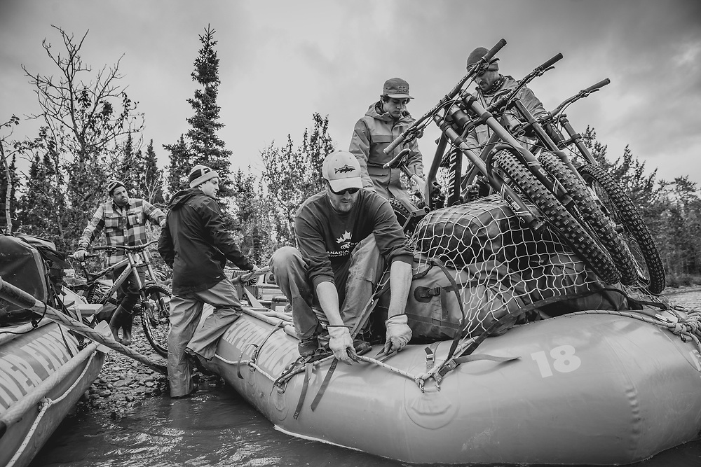 River guide Mike Neville along with Wade Simmons, Tyler McCaul, Carson Storch and Darren Berrecloth help load the rafts for a trip down the Tatshenshini River in the Tatshenshini-Alsek Provincial Park in British Columbia, Canada on August 31, 2016.
