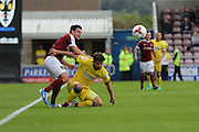 AFC Wimbledon midfielder Chris Whelpdale (11) and Northampton Town defender David Buchanan (3) during the EFL Sky Bet League 1 match between Northampton Town and AFC Wimbledon at Sixfields Stadium, Northampton, England on 20 August 2016. Photo by Stuart Butcher.