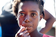 Venise Germain, 11.<br /> <br /> The story of Venise, Neuhaus heard from her mother and a local doctor. She herself has difficulties talking about what had happened. &quot;I cannot not feel guilty,&quot; says her mother, Isma. &quot;I sent my 11 year-old daughter to help a neighbor who had lost his wife and stayed by himself to take care of the children. She was supposed to help him with the house chores for a little money, hoping I would be able to feed my five children. After a few times she spent at his place, my daughter came back and asked me why did I let him do that. She did not give specifics, but she did not have to. I knew immediately. I went to talk to a few men who are helping me run the camp, and asked for their help. They tried to catch him, but he escaped. We reported the police, but as far as I know, they also did not manage to arrest him.&quot;<br /> <br /> Following what happened, the family was transferred to another camp and the authorities are trying to assist the mother with finding a job to provide for her family.