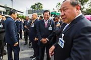 21 AUGUST 2014 - BANGKOK, THAILAND:    Air Chief Marshall ARKHOM KANCHANAHIRUN (center) of the Royal Thai Air Force and a member of the National Legislative Assembly (NLA) waits with other members of the NLA for their group picture to be made before meeting to select a new Prime Minister. The Thai National Legislative Assembly (NLA) met Thursday at the Parlimanet Building in Bangkok to select a new Prime Minster. The NLA was hand selected by the Thai junta, formally called the National Council for Peace and Order (NCPO), and is supposed to guide Thailand back to civilian rule after a military coup overthrew the elected government in May. The NLA unanimously selected General Prayuth Chan-ocha, commander of the Thai Armed Forces and leader of the coup in May that deposed the elected civilian government, as Prime Minister. Prayuth is Thailand's 29th Prime Minister since the 1932 coup that created Thailand's constitutional monarchy.          PHOTO BY JACK KURTZ