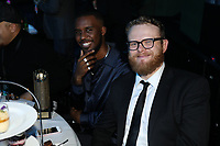 Novelist at his table with Radio 1s Huw Stephens