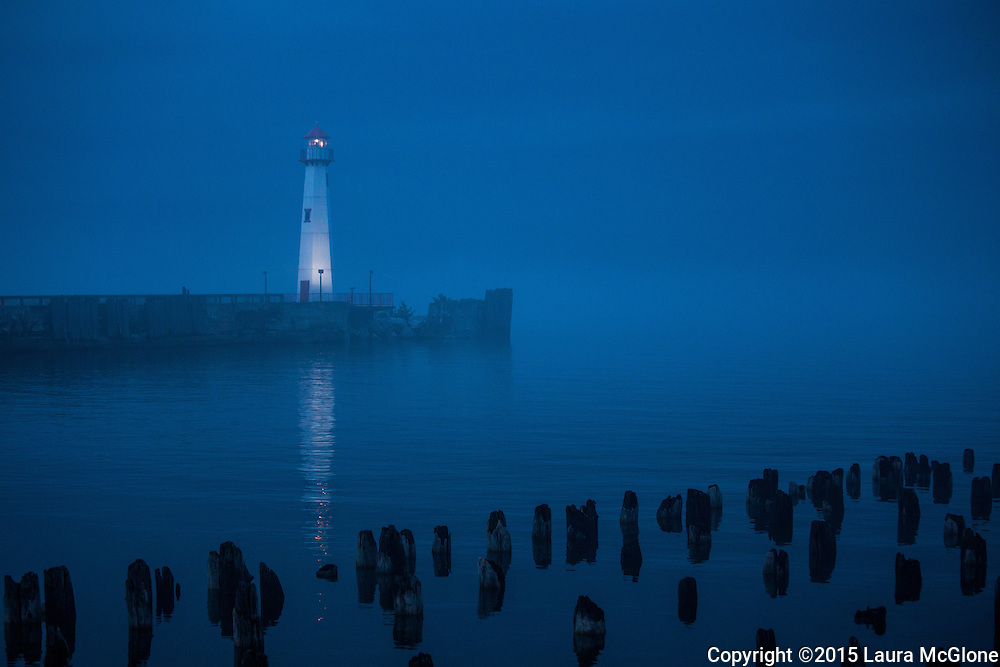 Lake Michigan Great Lakes Lighthouse at night in fog