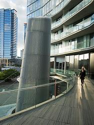 United States, Washington, Bellevue, winab walking on deck of Soma Towers.  MR