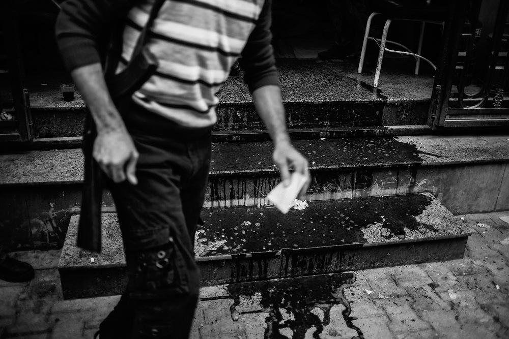 Aleppo, Syria, 2012/10/11.<br /> Tareeq Al-Bab district.<br /> Trickle of blood falling down from the Dar Al-Shifaa hospital's steps.
