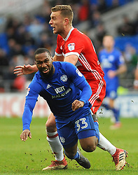 Ben Gibson of Middlesbrough fouls Junior Hoilett of Cardiff City- Mandatory by-line: Nizaam Jones/JMP - 17/02/2018 -  FOOTBALL - Cardiff City Stadium - Cardiff, Wales -  Cardiff City v Middlesbrough - Sky Bet Championship