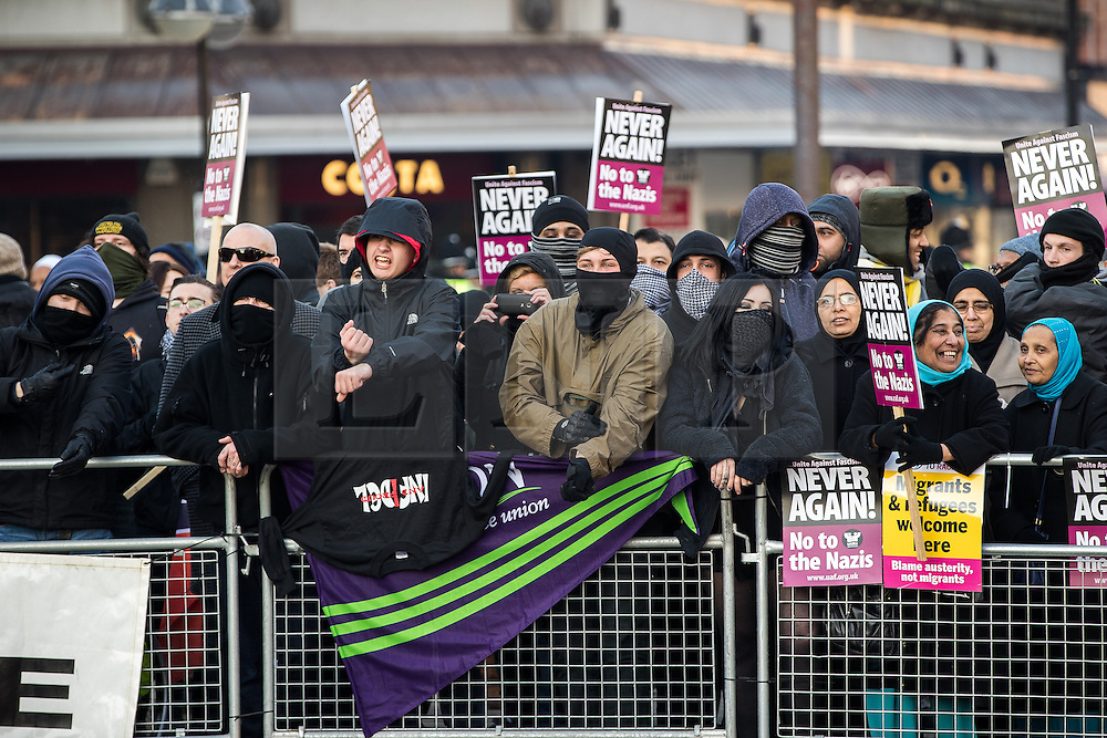 """© Licensed to London News Pictures . 26/11/2016 . Bolton , UK . Anti fascists pictured holding a counter demonstration . Approximately 100 people attend a demonstration against the construction of mosques in Bolton , under the banner """" No More Mosques """" , organised by a coalition of far-right organisations and approximately 150 anti fascists opposing the demonstration , in Victoria Square in Bolton Town Centre . Photo credit : Joel Goodman/LNP"""