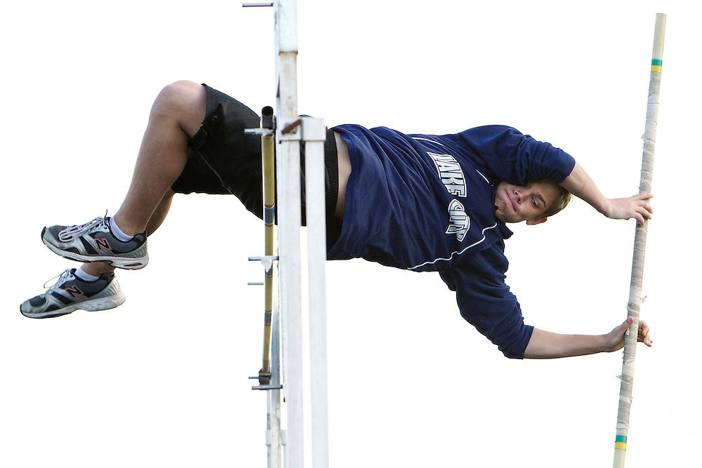 Lake City High's Isaac Cunnington pushes the pole away as he clears the bar at 10-feet Tuesday.