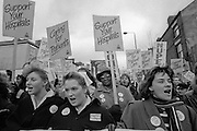 Nurses join other health workers for a NHS Day of Action, Nottingham. 04-02-1988.