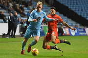 Wycombe Wanderers striker Nathan Tyson (23) tackles Coventry City defender Jack Grimmer (2) 0-0 during the EFL Sky Bet League 2 match between Coventry City and Wycombe Wanderers at the Ricoh Arena, Coventry, England on 22 December 2017. Photo by Alan Franklin.