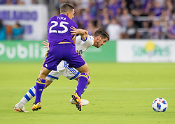 June 23, 2018 - Orlando, FL, U.S. - ORLANDO, FL - JUNE 23: Orlando City defender Donny Toia (25) tries to dispossess Montreal Impact defender Daniel Lovitz (3) During the MLS soccer match between the Orlando City SC and Montreal Impact on June 23rd, 2018 at Orlando City Stadium in Orlando, FL. (Photo by Andrew Bershaw/Icon Sportswire) (Credit Image: © Andrew Bershaw/Icon SMI via ZUMA Press)