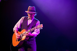 Roy Rogers -  blues slide guitarist in concert at the Triple Door Dinner Theater, Seattle, WA, USA