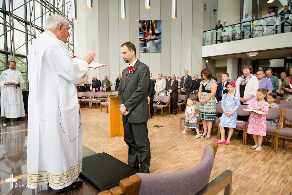 Christian J. Boehlke, director of Missionary Services at the LCMS, is installed by the Rev. Dr. Ray Mirly, president of the LCMS Missouri District, during a Service of Installation for Boehlke at the International Center of The Lutheran Church--Missouri Synod on Monday, April 28, 2014, in Kirkwood, Mo. LCMS Communications/Erik M. Lunsford