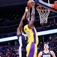 09 March 2018: Los Angeles Lakers forward Julius Randle (30) goes for the dunk past Denver Nuggets forward Will Barton (5) during the Denver Nuggets125-116 victory over the Los Angeles Lakers, at the Pepsi Center, Denver, Colorado, USA.