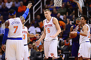 Mar 9, 2016; Phoenix, AZ, USA; New York Knicks forward Kristaps Porzingis (6) is congratulated by teammates in the game against the Phoenix Suns at Talking Stick Resort Arena. Mandatory Credit: Jennifer Stewart-USA TODAY Sports