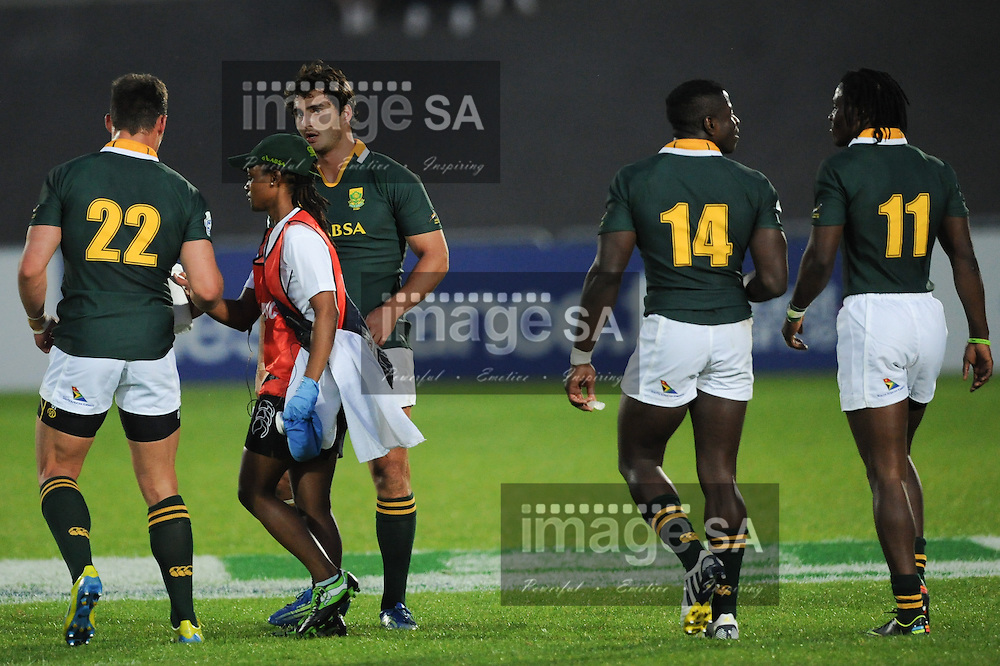 LA ROCHE-SUR-YON, FRANCE - JUNE 05: Dr Patho Zondi with Jesse Kriel and Dries Swanepoel of South Africa during the 2013 IRB Junior World Championship match between South Africa and United States of America at Stade Henri Degranges on June 05, 2013 in La Roche-sur-Yon, France. (Photo by Roger Sedres)