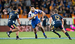 Stormers' Damian de Allende, centre, looks to beat Highlanders' Siate Tokolahi, left, as Teihorangi Walden looks to line up a tackle in the Super Rugby match, Forsyth Barr Stadium, Dunedin, New Zealand, Friday, March 9, 2018. Credit:SNPA / Adam Binns ** NO ARCHIVING**