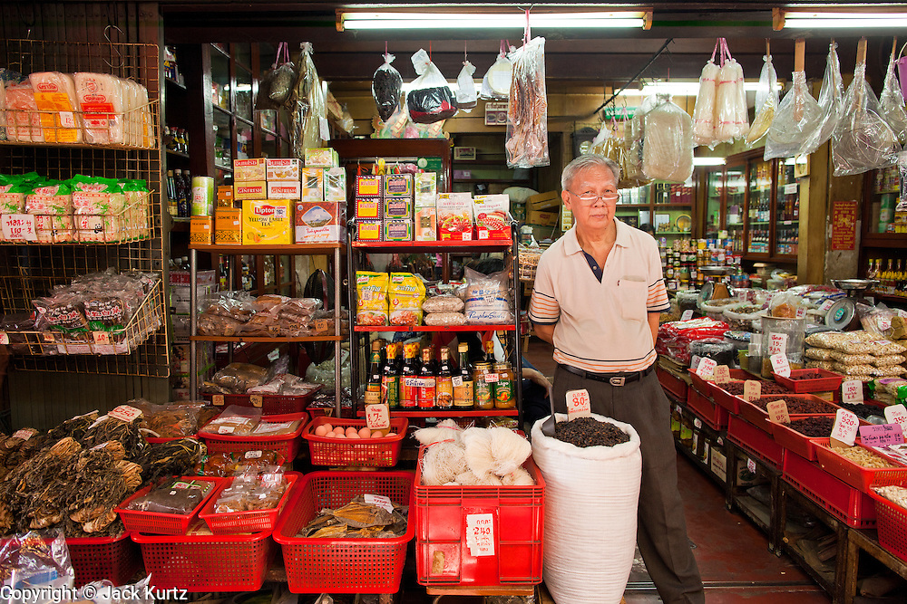 09 JULY 2011 - BANGKOK, THAILAND: A man in his shop in the Chinatown section of Bangkok, Thailand. Chinatown is the entrepreneurial hub of Bangkok, with thousands of family owned businesses selling wholesale merchandise in everything from food like rice, peanuts and meats, to dry goods like toys and shoes.  PHOTO BY JACK KURTZ