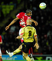 Photo: Leigh Quinnell/Sportsbeat Images.<br /> Watford v Bristol City. Coca Cola Championship. 01/12/2007. Bristol Citys Marvin Elliott rises high to collect the ball before Watfords Gavin Mahon.