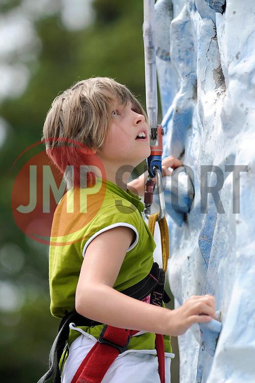 A fan climbs the Everest Challenge at the Fun Day - Photo mandatory by-line: Dougie Allward/JMP - Mobile: 07966 386802 27/07/2014 - SPORT - FOOTBALL - Bristol - Bristol Rovers - - Memorial Stadium - Fun Day