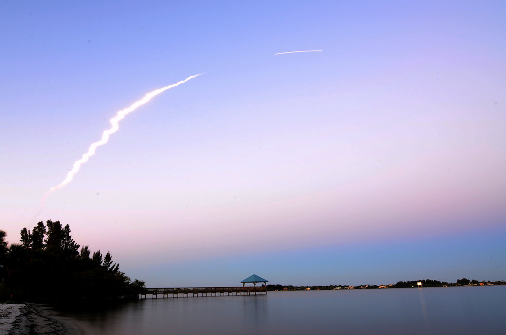 Andrew Knapp, FLORIDA TODAY -- March 11, 2010 -- A Delta IV rocket arcs toward space in this time-lapse photograph taken Friday at Rotary Park in Suntree.