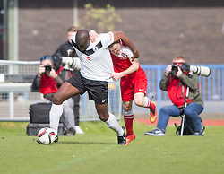 Edinburgh City's Joseph Mbu held by Brora Rangers Alexander Sutherland. <br /> Edinburgh City 1 v 1 Brora Rangers, 1st leg, Pyramid Playoffs at Meadowbank, 25/4/2015.