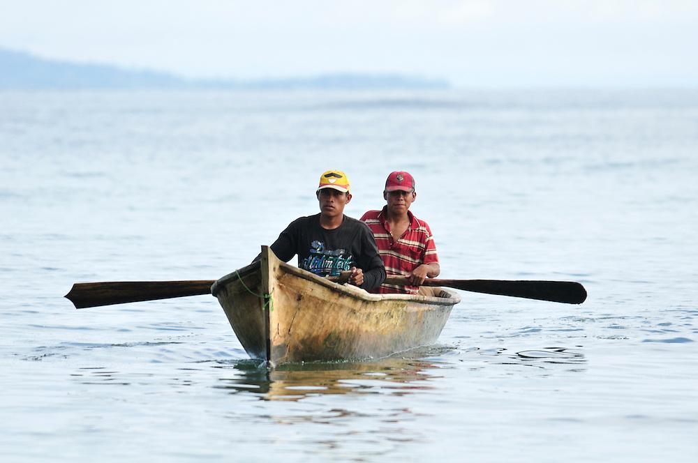 Fishermen in boat at El Limbo Hotel, Bastimentos Island, Caribbean Sea, Bocas del Toro, Panama, Central America