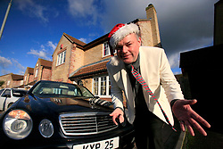 UK ENGLAND WILTSHIRE MELKSHAM 17DEC09 - Andy Park, self-proclaimed Mr Christmas shows off his christmas present, a Mercedes E-class car as he celebrates Christmas every day at his home in Melksham, Wiltshire. Mr Park, a 45-year-old divorced electrician, has consumed nearly 118,000 brussel sprouts and about 5000 bottles of Moet champagne since he decided to get into the festive spirit full-time in July 1994.jre/Photo by Jiri Rezac© Jiri Rezac 2009